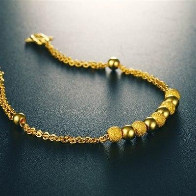 目前市场上黄金材质的手链款式多种多样,心形的,花型的……选对了合适图片